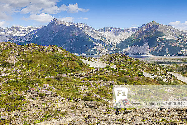Two women backpackers head towards the Katmai River  Valley of Ten Thousand Smokes  Katmai National Park and Preserve  Southwest Alaska; Alaska  United States of America