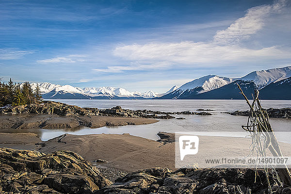 The in-coming tide on a calm winter day on the Turnagain Arm in South-central Alaska. The Chugach State Park and Chugach Mountains are in the background; Alaska  United States fo America
