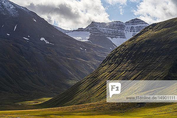 The scenery of the Trollaskagi peninsula in Northern Iceland. Dappled light illuminates the landscape; Iceland