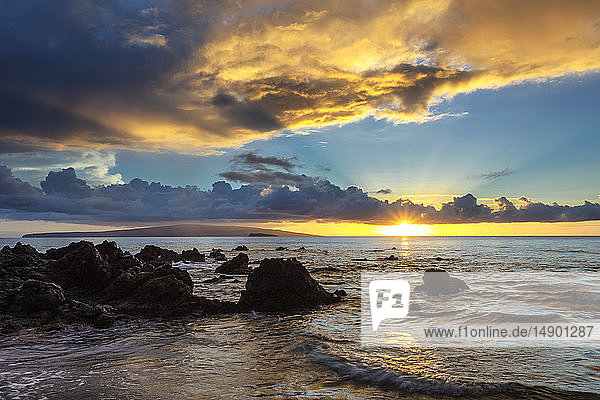 Dramatic clouds during a sunset; Makena  Maui  Hawaii  United States of America