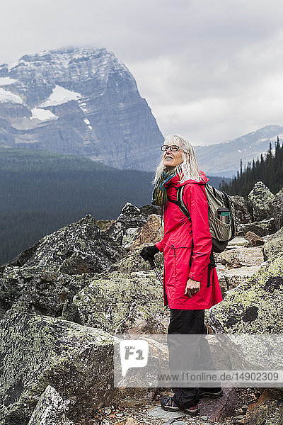 Female hiker looking up at the Rocky Mountains  Yoho National Park; British Columbia  Canada