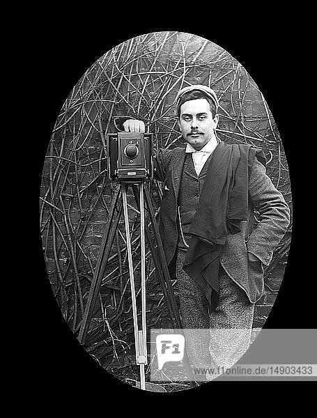 Magic lantern slide circa 1880.Victorian/Edwardian.Social History. Slide set: A photographer and tripod posing for a photograph in 1897. Initials C.G.M