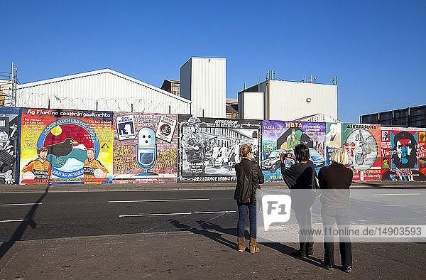 Republican murals  known as the 'International Wall'  depicting scenes from all over the world  in particular the Middle East  on Falls Road in West Belfast; Belfast  Ireland