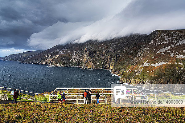 Tourists overlooking the coastline at Slieve League; County Donegal  Ireland