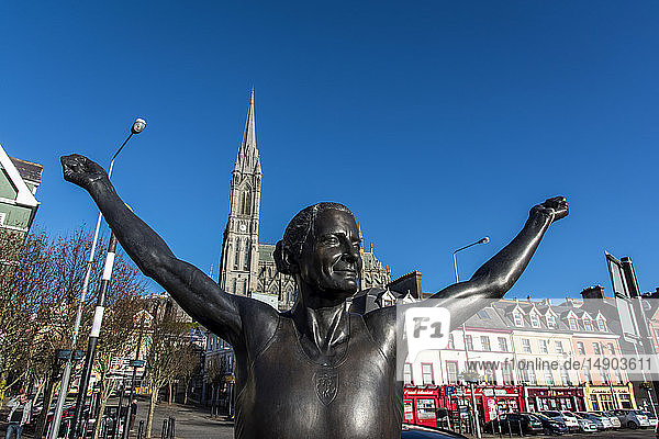 Bronze statue of Irish olympian Sonia O'Sullivan with St. Coleman's Cathedral in the background; Cobh  County Cork  Ireland