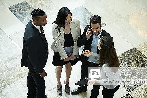 Business people discussing in hotel lobby