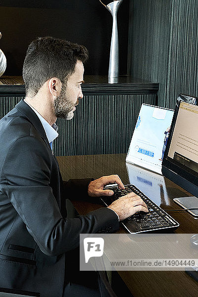Businessman working on computer in hotel