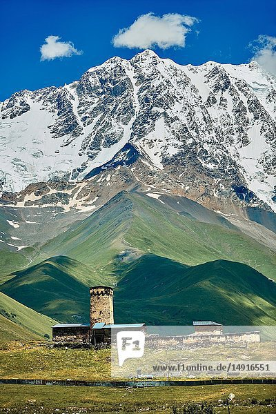 """The medieval Georgian Orthodox St George Church """"JGRag with mount Shkhara (5193m) behind  Ushguli  Upper Svaneti  Samegrelo-Zemo Svaneti  Mestia  Georgia. At 2 200 m (7217 ft) above sea level in the Caucasus mountains St George Church is one of the highest in Europe. Mount Shkhara is the highest mountain in the Caucasus range."""