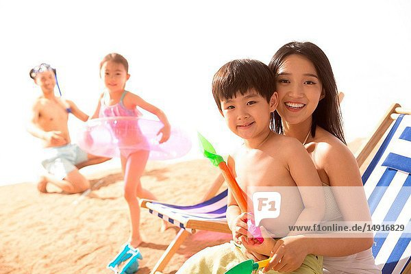 Happy family play on the beach