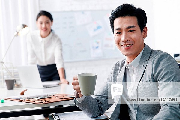 Youth business men and women in the office