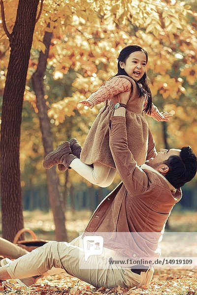 Father and daughter play outdoors