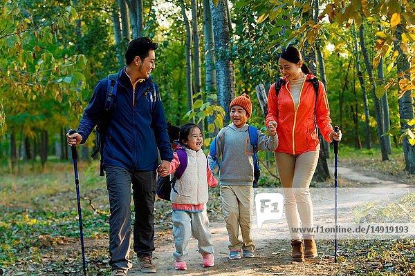 Happy family hiking