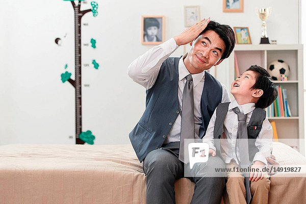 Dress up the father and son