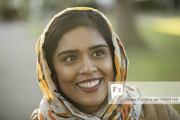 Portrait smiling  happy Muslim woman wearing hijab