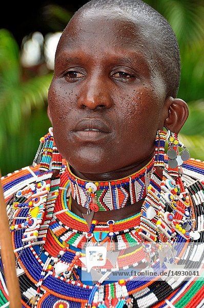 Kenya: A beautifull Masai Women artist with tradition colour glass perls around her neck.