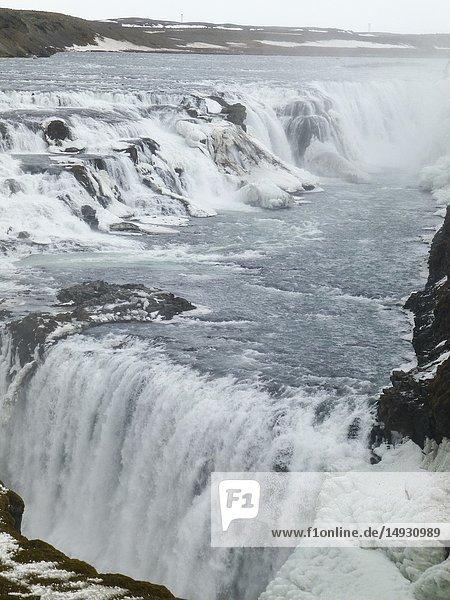 Amazing Icelandic winter landscape of majestic waterfall of frozen Gullfoss.