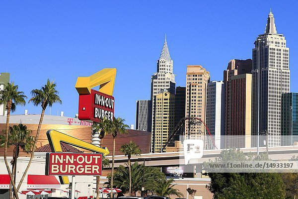 In-n-Out burger restaurant with skyscrapers of New York NY Las Vegas in the background.