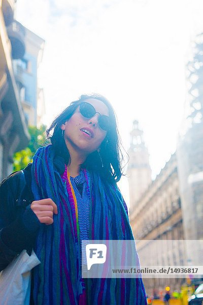 Caucasian female model poses for pictures at the tourists destination Barcelona  Spain. Barcelona is known as an Artistic city located in the east coast of Spain.