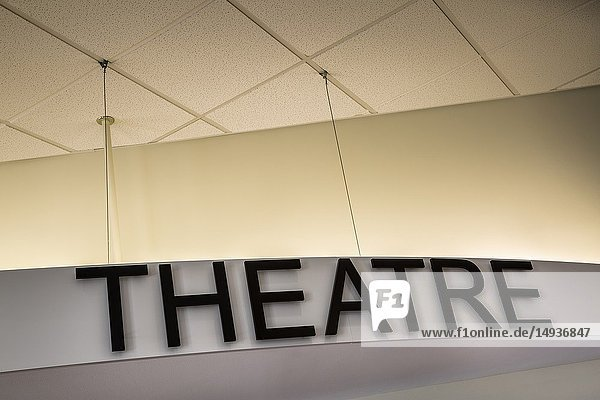 Close-up of a theater marquee with 'Theatre' written on it.