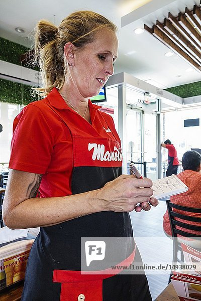 Florida  Miami Beach  North Beach  Manolo  Argentinean  restaurant  inside  employee waitress writing order working  Hispanic  woman