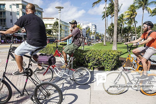 Florida  Miami Beach  Ocean Drive  tall bike bikes rider riders  Black  man