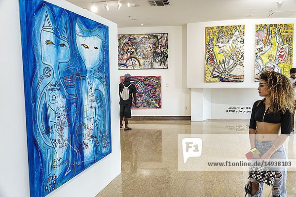 Florida  Miami Beach  Collins Avenue  Sagamore  hotel  Art Basel  lobby  paintings sale display  Frame  woman  looking  Middle Eastern