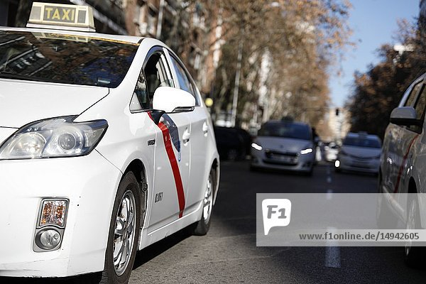 Taxi moving through the streets of Madrid. Madrid taxi drivers demonstrate to request that the proportion of one Transport Vehicle with Driver (VTC) be met for every 30 taxis in the Community of Madrid on Jan 9  2019 in Madrid  Spain