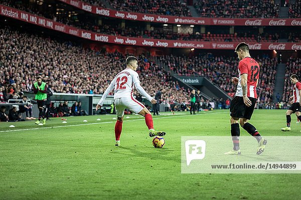 Andre Silva (L) and Yuri Berchiche (R) dispute the ball in the Spanish League match between Athletic Club Bilbao and Sevilla FC at San Mames Stadium on January 13  2019 in Bilbao  Spain