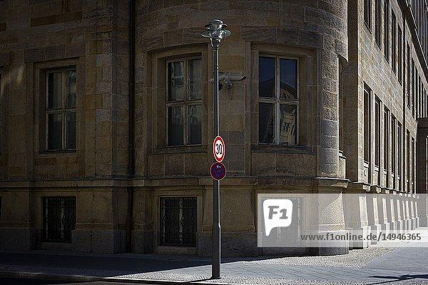 An empty sunlit street in Berlin,  Germany.