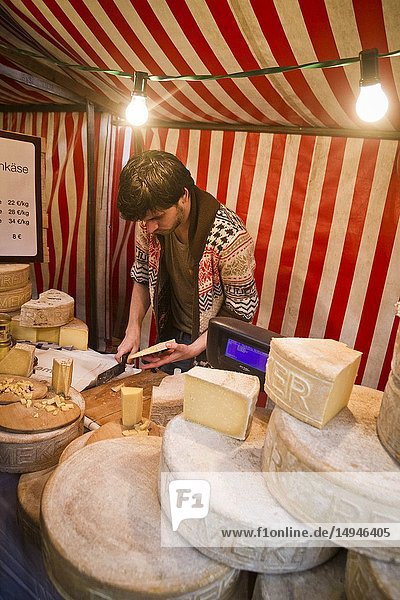 A vendor selling cheese at a food fair in Berlin,  Germany.