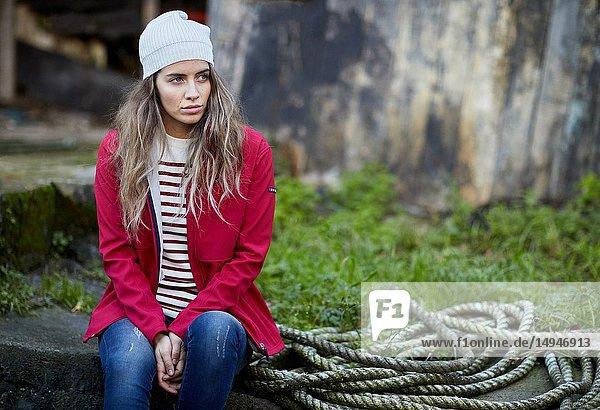 Young woman  Port  Mutriku  Gipuzkoa  Basque Country  Spain
