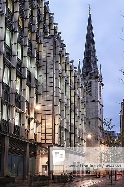 England  City of London Rood Lane- contemporary office buildings and Saint Margaret Pattens Church of england at night. The church's exterior is notable for its 200-ft high spire  Wren's third highest and the only one that he designed in a medieval style.