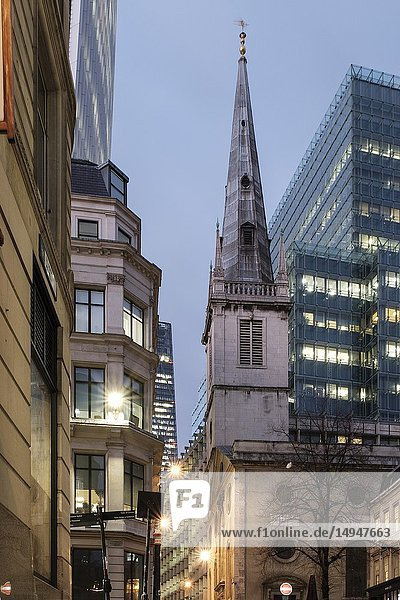 England  City of London St Mary at Hill- contemporary office buildings and Saint Margaret Pattens Church of england at night. The church's exterior is notable for its 200-ft high spire  Wren's third highest and the only one that he designed in a medieval style.