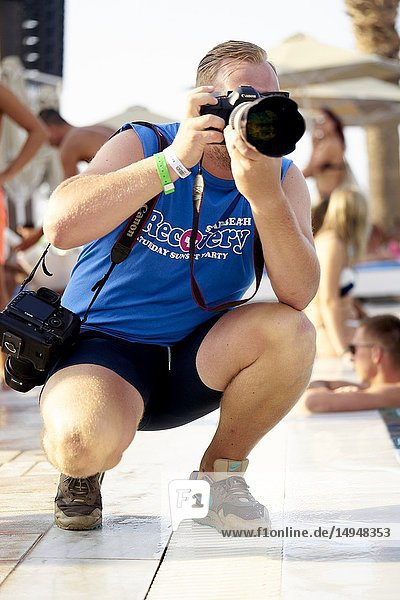 Photographer Richard Brunsveld taking festival photos at Recovery Pool Party at Starbeach Chersonissos,  Crete,  Greece,  on 03. August 2018