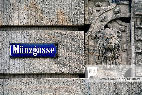 Munzgasse street name plate on the wall of Iwalewahaus building  mission of Iwalewahaus is to research  document and teach recent African culture  Munzgasse street is in historic part of Bayreuth city next to Margravial Opera House  Bayreuth - capital of Upper Franconia  Bavaria  Bayern  Germany  Europe