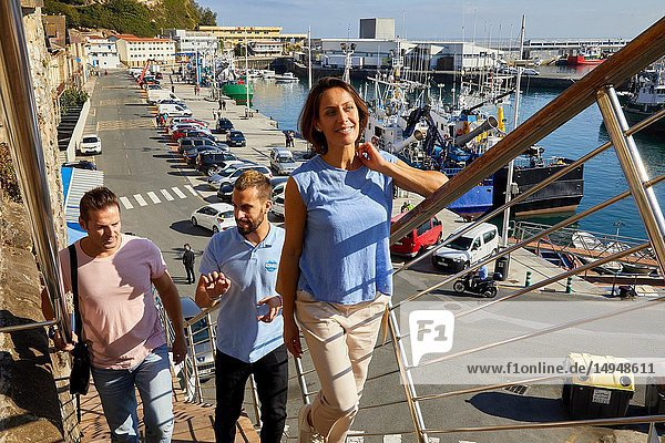 Guide with tourists  Tour  Port  Getaria  Basque Country  Spain  Europe