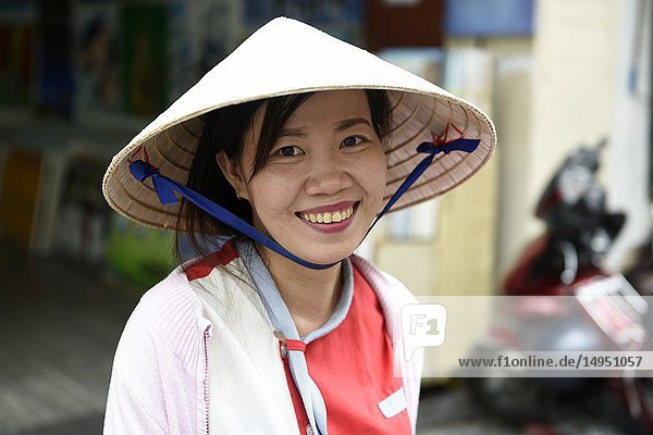 Portrait of a Vietnamese smiling woman Ho Chi Minh City Vietnam South East Asia.