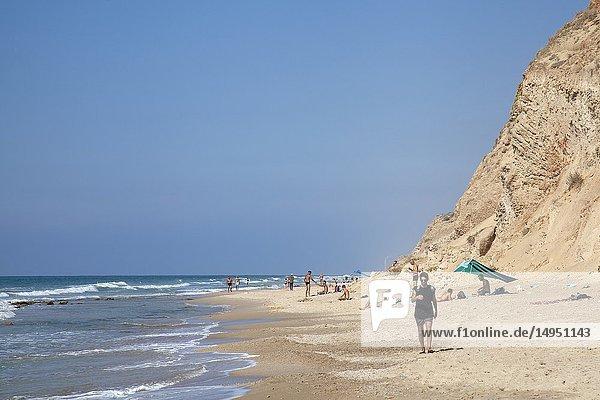 Locals on Nudist Beach at Sharon Beach National Park near Tel Aviv  Israel.