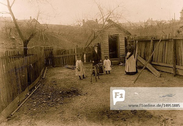 African American family standing in a yard in Georgia