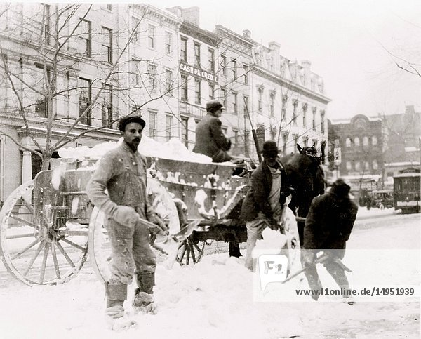 African American men shoveling snow in street  Washington  D.C.
