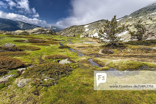 Thaw at National Park of Penialara Lagoons and Cuerda Larga on the background. Sierra de Guadarrama. Madrid. Spain.