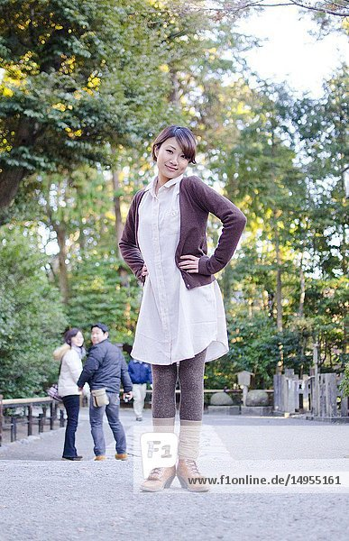 Japanese Girl poses on the street in Kamakura  Japan. Kamakura is an area located in Kanagawa where is a bit south of Tokyo.