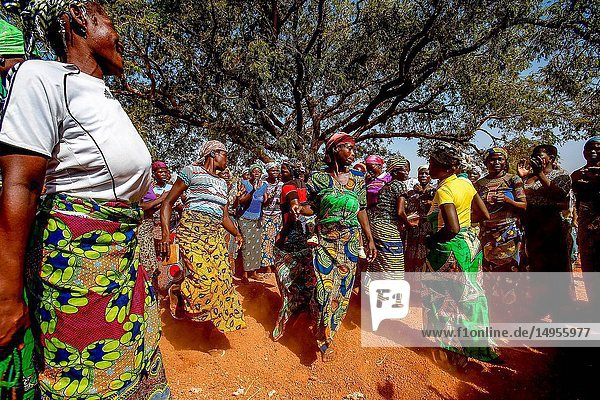 Members of a women's microfinance cooperative welcoming a visitor with dances in Northern Togo.