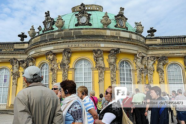 Potsdam  Brandenburg  Germany  Europe - Tourists at the Southern facade of Sanssouci Palace  the summer palace of the Prussian King Frederick the Great.