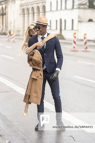 Blogger couple at street  Munich  Germany.