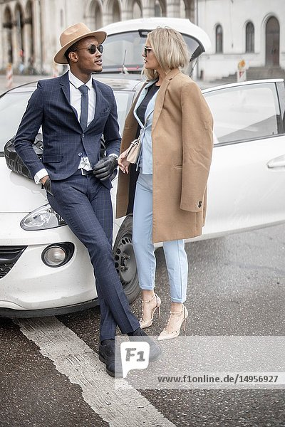 Couple  car  fashionable  blogger  style  street  city  in Munich  Germany.