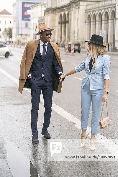 Blogger couple at street  Munich  Germany.