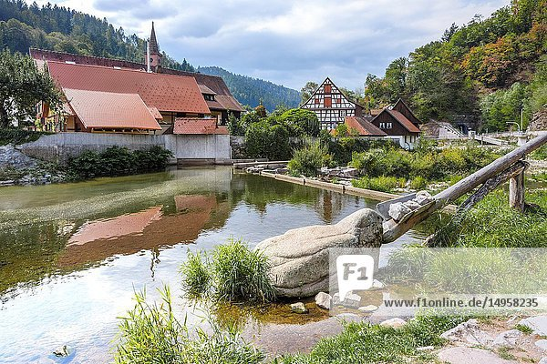 Historical barrage of the river Kinzig  town Schiltach  Black Forest  Germany  the Gamben construction on the right was used to open the barrage and start the floats with timber.