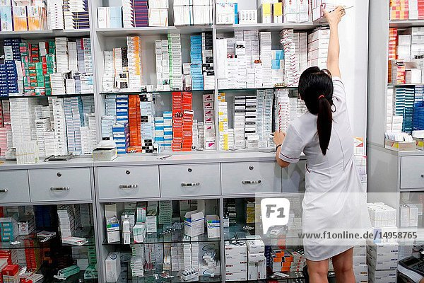 Hospital pharmacy. Pharmacist checking inventory. Ho Chi Minh City. Vietnam.