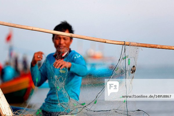 Fishermen repairing fishing nets. Hang Dua bay. Vung Tau. Vietnam.